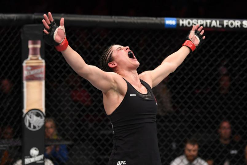 Julia Avila reacts after the conclusion of her bout against Pannie Kianzad of Sweden in their bantamweight fight during the UFC 239