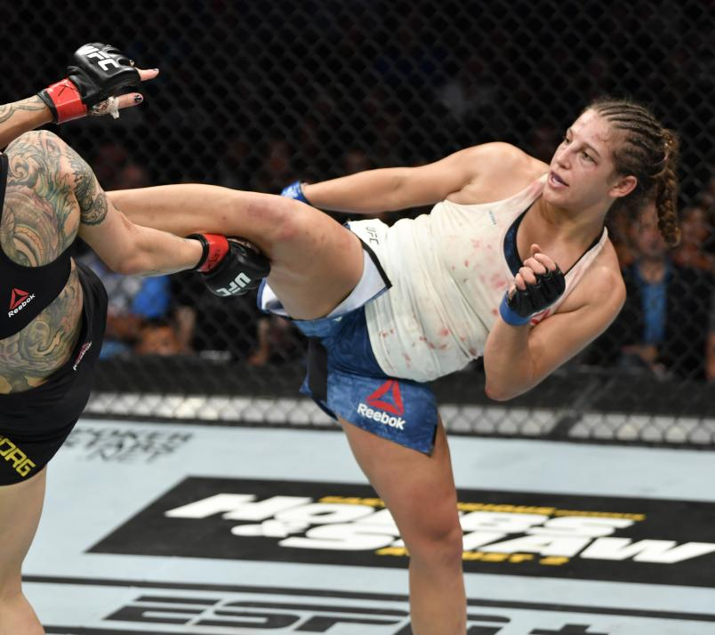 Felicia Spencer of Canada kicks Cris Cyborg of Brazil in their featherweight bout during the UFC 240