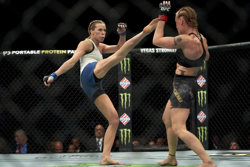 Katlyn Chookagian kicks Valentina Shevchenko of Kyrgyzstan in their women's flyweight championship bout during the UFC 247