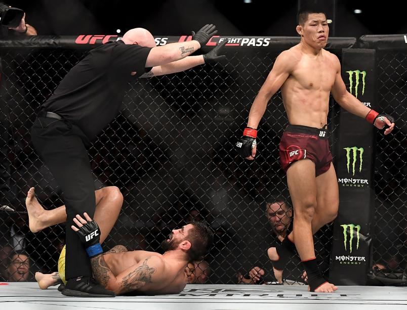 Li Jingliang of China celebrates after his TKO victory over Elizeu dos Santos of Brazil in their welterweight bout during the UFC Fight Night event at Shenzhen Universiade Sports Centre on August 31, 2019 in Shenzhen, China. (Photo by Zhe Ji/Getty Images)