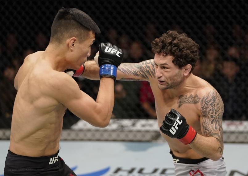 Frankie Edgar punches Chan Sung Jung of South Korea