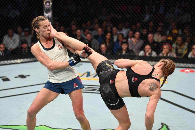 Valentina Shevchenko of Kyrgyzstan kicks Katlyn Chookagian in their women's flyweight championship bout during the UFC 247