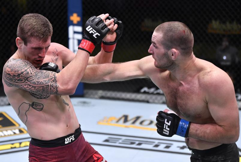 LAS VEGAS, NEVADA - NOVEMBER 14: (R-L) Sean Strickland punches Brendan Allen in a 195-pound catchweight fight during the UFC Fight Night