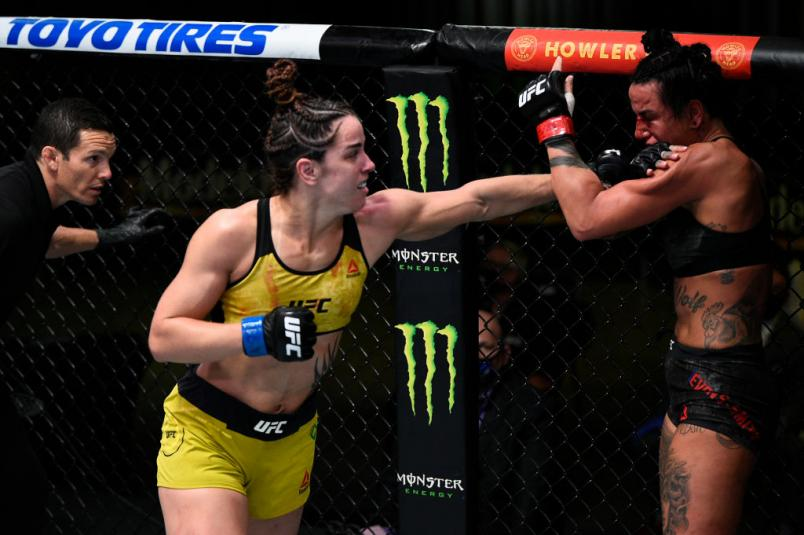 LAS VEGAS, NEVADA - NOVEMBER 28: (L-R) Norma Dumont of Brazil punches Ashlee Evans-Smith in their women's bantamweight bout during the UFC Fight Night