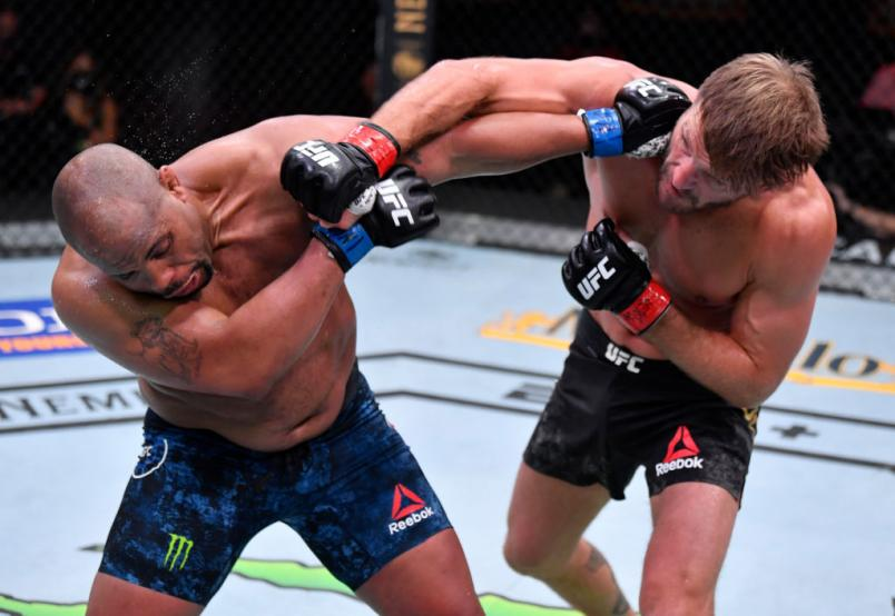 LAS VEGAS, NEVADA - AUGUST 15: (R-L) Stipe Miocic punches Daniel Cormier in their UFC heavyweight championship bout during the UFC 252