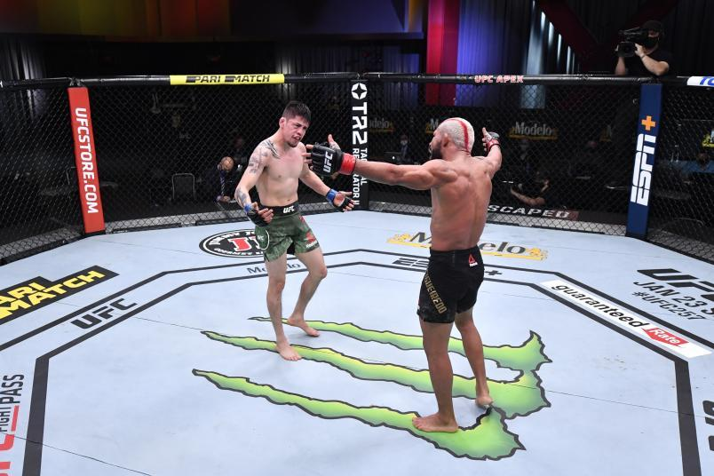 Brandon Moreno of Mexico and Deiveson Figueiredo of Brazil react after their flyweight championship bout during the UFC 256 event at UFC APEX on December 12, 2020 in Las Vegas, Nevada. (Photo by Jeff Bottari/Zuffa LLC)