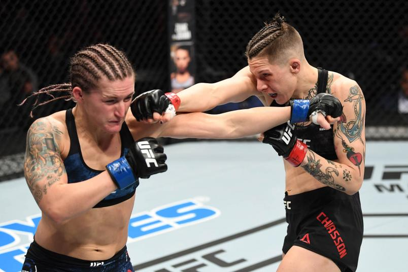 Macy Chiasson punches Shanna Young in their women's bantamweight bout during the UFC Fight Night event at Santa Ana Star Center on February 15, 2020 in Rio Rancho, New Mexico. (Photo by Josh Hedges/Zuffa LLC)