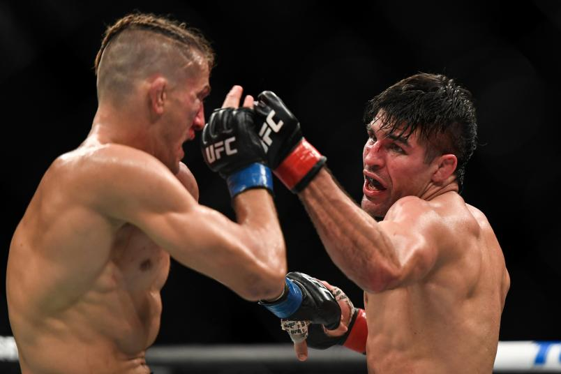 JACKSONVILLE, FL - MAY 09: Vicente Luque (R) of the United States looks to punch Niko Price (L) of the United States in their Welterweight fight during UFC 249