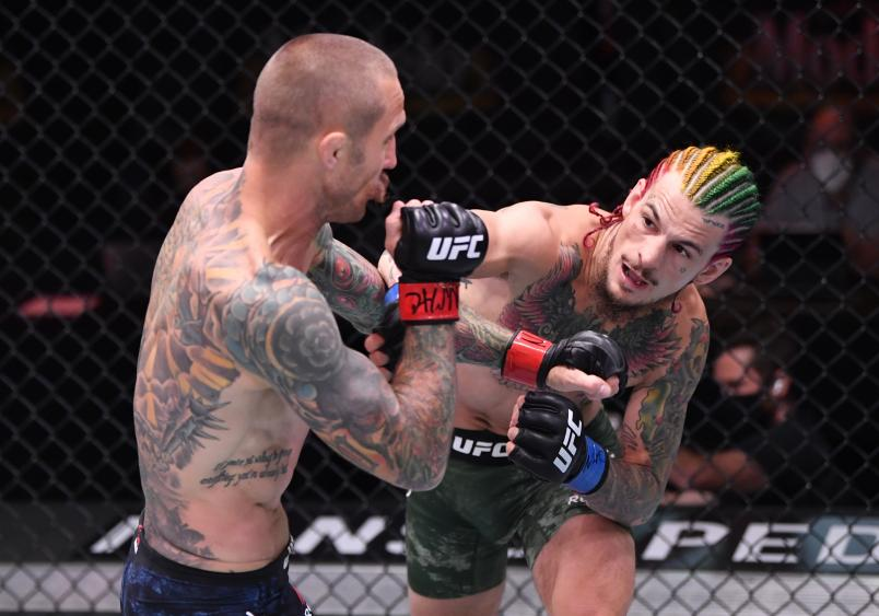 LAS VEGAS, NEVADA - JUNE 06: (R-L) Sean O'Malley punches Eddie Wineland in their bantamweight bout during the UFC 250 event at UFC APEX