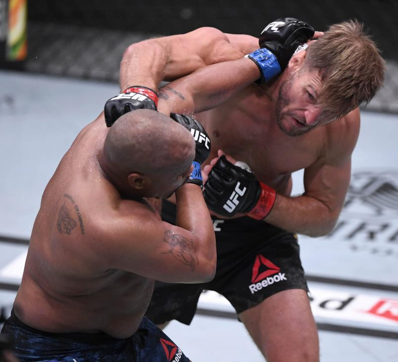 Stipe Miocic punches Daniel Cormier in their UFC heavyweight championship bout during the UFC 252 event at UFC APEX on August 15, 2020 in Las Vegas, Nevada. (Photo by Chris Unger/Zuffa LLC)