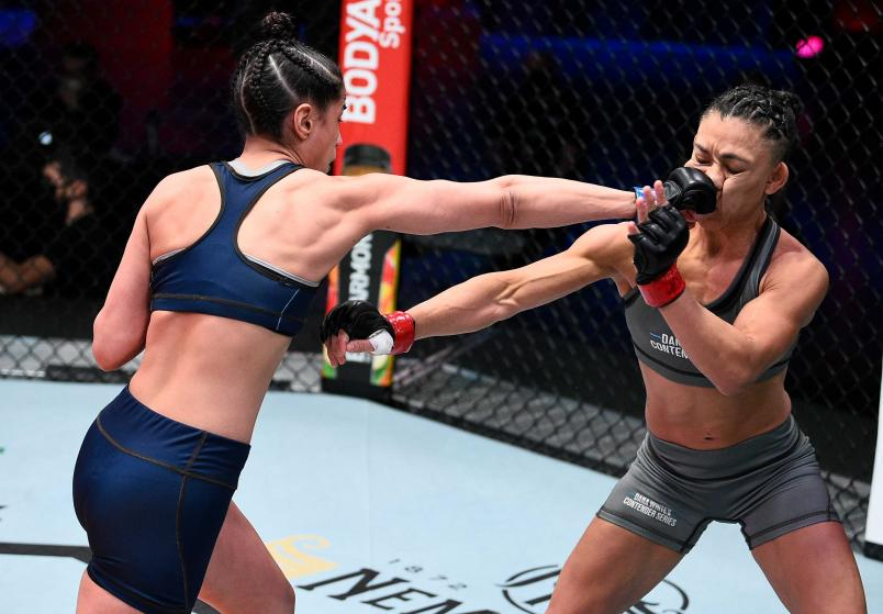 (L-R) Gloria de Paula punches Pauline Macias in a strawweight bout during Dana White's Contender Series season four week ten at UFC APEX on November 17, 2020 in Las Vegas, Nevada. (Photo by Chris Unger/DWCS LLC/Zuffa LLC)