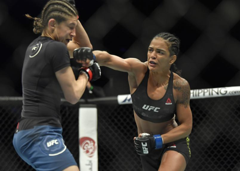 ABU DHABI, UNITED ARAB EMIRATES - JANUARY 20: (R-L) Viviane Araujo of Brazil punches Roxanne Modafferi in a flyweight fight during the UFC Fight Night event