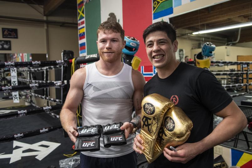 Canelo Alvarez and Brandon Moreno exchange gloves