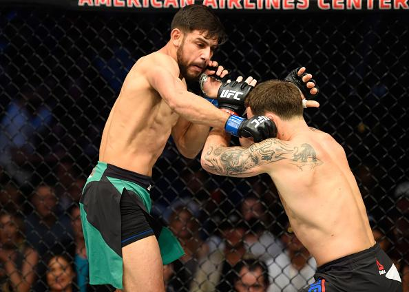 DALLAS, TX - MAY 13:  (L-R) Yair Rodriguez punches Frankie Edgar in their featherweight fight during the UFC 211 event at the American Airlines Center on May 13, 2017 in Dallas, Texas. (Photo by Josh Hedges/Zuffa LLC/Zuffa LLC via Getty Images)