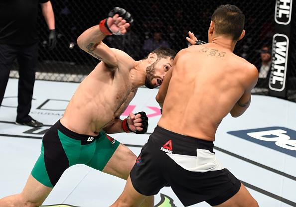 MEXICO CITY, MEXICO - NOVEMBER 05:  (L-R) Marco Polo Reyes of Mexico punches Jason Novelli of the United States in their lightweight bout during the UFC Fight Night event at Arena Ciudad de Mexico on November 5, 2016 in Mexico City, Mexico. (Photo by Jeff