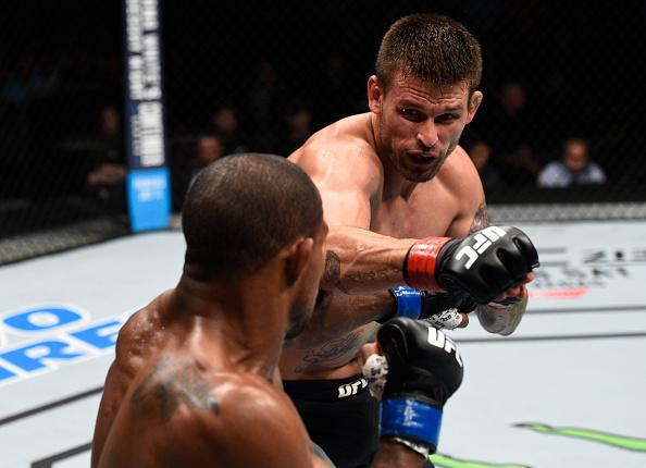 OKLAHOMA CITY, OK - JUNE 25:   (R-L) Tim Means punches Alex Garcia of the Dominican Republic in their welterweight bout during the UFC Fight Night event at the Chesapeake Energy Arena on June 25, 2017 in Oklahoma City, Oklahoma. (Photo by Brandon Magnus/Z