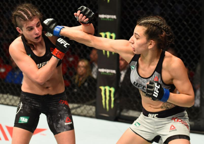 SYDNEY, AUSTRALIA - NOVEMBER 19:  (R-L) Nadia Kassem punches Alex Chambers of Australia in their women's strawweight bout during the UFC Fight Night event inside the Qudos Bank Arena on November 19, 2017 in Sydney, Australia. (Photo by Josh Hedges/Zuffa L