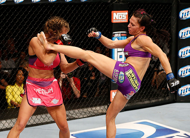 LAS VEGAS, NV - APRIL 13:   (R-L) Cat Zingano kicks Miesha Tate in their bantamweight fight at the Mandalay Bay Events Center  on April 13, 2013 in Las Vegas, Nevada.  (Photo by Josh Hedges/Zuffa LLC/Zuffa LLC via Getty Images)  *** Local Caption *** Mies