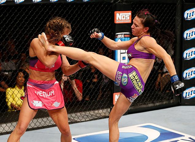 LAS VEGAS, NV - APRIL 13:   (R-L) Cat Zingano kicks Miesha Tate in their bantamweight fight at the Mandalay Bay Events Center  on April 13, 2013 in Las Vegas, Nevada.  (Photo by Josh Hedges/Zuffa LLC/Zuffa LLC via Getty Images)  *** Local Caption *** Mies