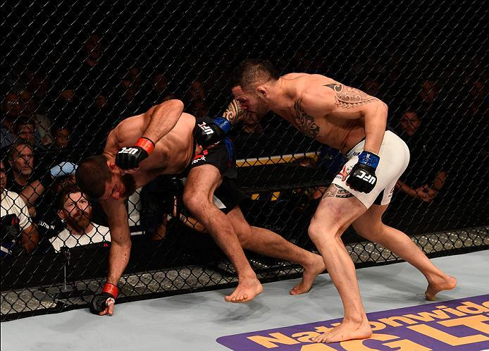 TAMPA, FL - APRIL 16:   (R-L) Santiago Ponzinibbio punches Court McGee in their welterweight bout during the UFC Fight Night event at Amalie Arena on April 16, 2016 in Tampa, Florida. (Photo by Jeff Bottari/Zuffa LLC/Zuffa LLC via Getty Images)