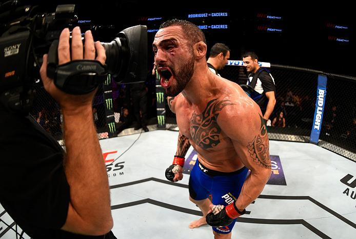 Santiago Ponzinibbio of Argentina raises his hand after facing Zak Cummings in their welterweight bout during the UFC Fight Night event at Vivint Smart Home Arena on August 6, 2016 in Salt Lake City, Utah. (Photo by Jeff Bottari/Zuffa LLC)