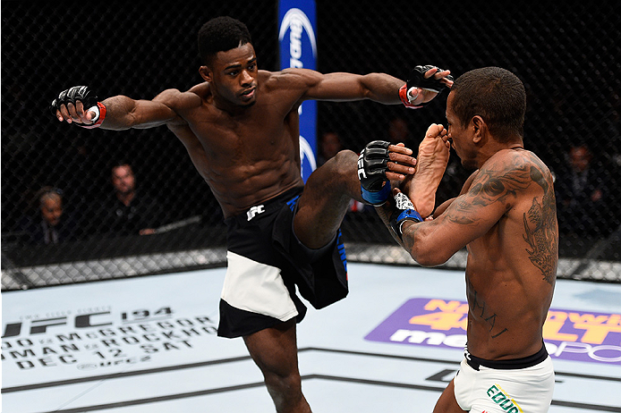 LAS VEGAS, NEVADA - DECEMBER 10:  (L) Aljamain Sterling kicks Johnny Eduardo in their bantamweight bout during the UFC Fight Night event at The Chelsea at the Cosmopolitan of Las Vegas on December 10, 2015 in Las Vegas, Nevada.  (Photo by Jeff Bottari/Zuf