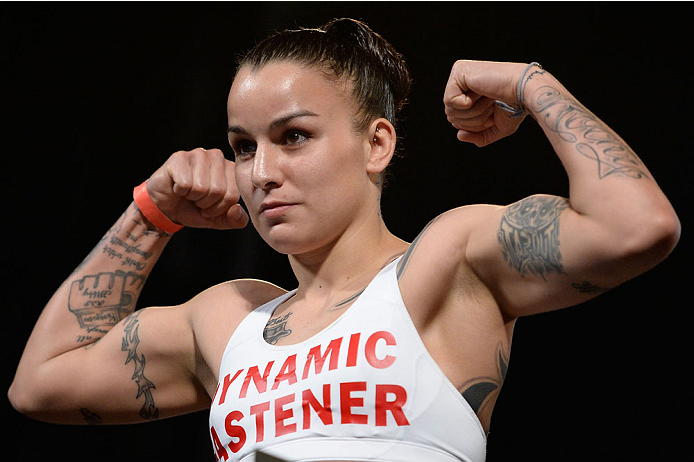 DALLAS, TX - MARCH 14:  Raquel Pennington steps on the scale during the UFC 171 weigh-in event at Gilley's Dallas on March 14, 2014 in Dallas, Texas. (Photo by Jeff Bottari/Zuffa LLC/Zuffa LLC via Getty Images)
