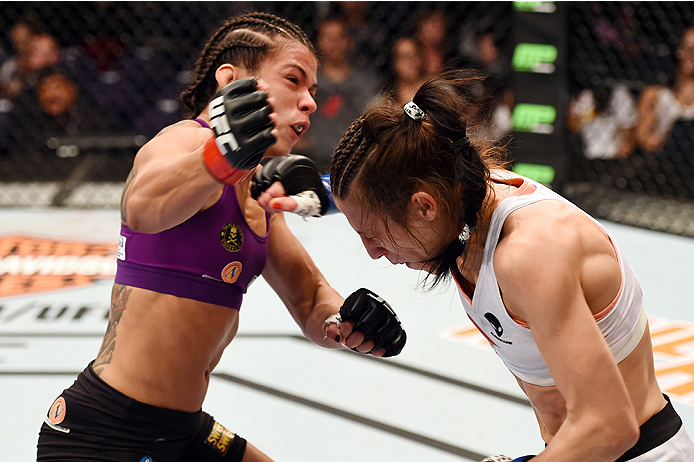 PHOENIX, AZ - DECEMBER 13:  Claudia Gadelha of Brazil punches Joanna Jedrzejczyk of Poland in their women's strawweight fight during the UFC Fight Night event at the U.S. Airways Center on December 13, 2014 in Phoenix, Arizona.  (Photo by Josh Hedges/Zuff