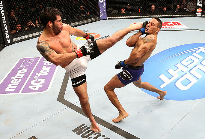 Raphael Assuncao kicks Mike Easton during their bantamweight bout at the UFC on FOX event on December 8, 2012 at Key Arena in Seattle, Washington. (Photo by Ezra Shaw/Zuffa LLC/Zuffa LLC via Getty Images)
