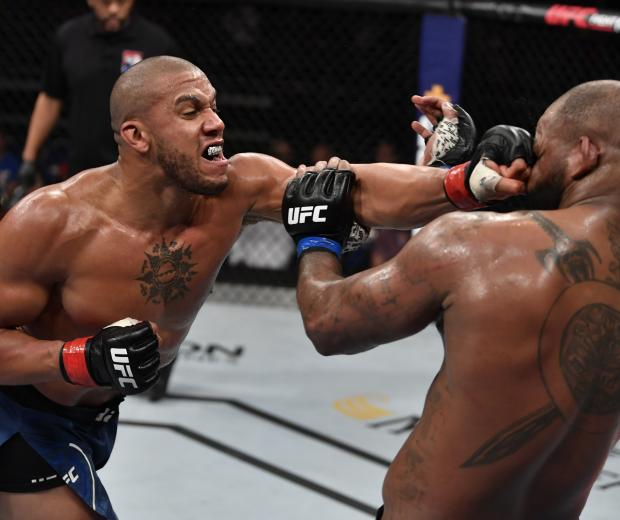SINGAPORE, SINGAPORE - OCTOBER 26: (L-R) Ciryl Gane of France punches Don'Tale Mayes in their heavyweight bout during the UFC Fight Night event at Singapore Indoor Stadium on October 26, 2019 in Singapore. (Photo by Jeff Bottari/Zuffa LLC via Getty Images)