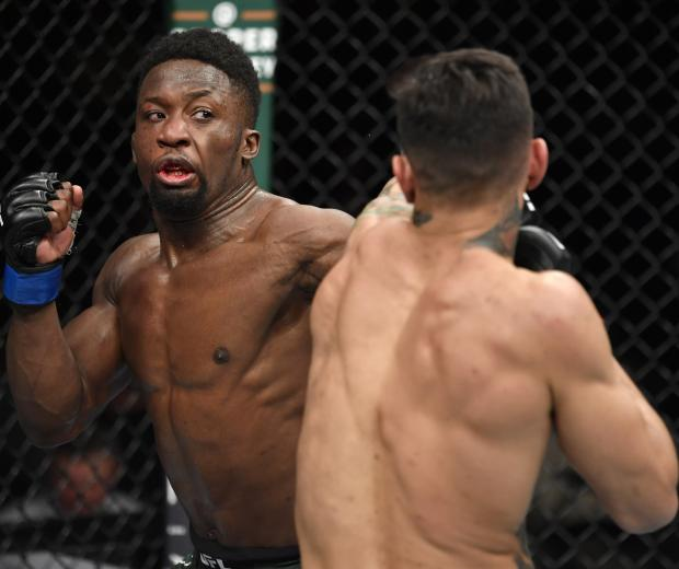 LAS VEGAS, NEVADA - JANUARY 18: Sodiq Yusuff of Nigeria punches Andre Fili in their featherweight fight during the UFC 246 event at T-Mobile Arena on January 18, 2020 in Las Vegas, Nevada. (Photo by Jeff Bottari/Zuffa LLC via Getty Images)