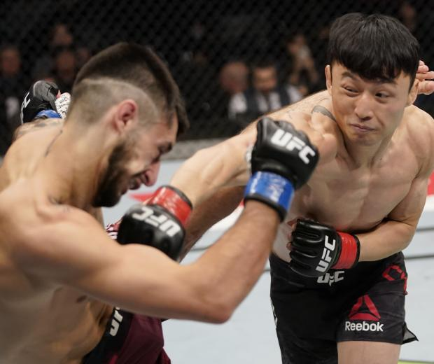 BUSAN, SOUTH KOREA - DECEMBER 21: (R-L) Dooho Choi of South Korea punches Charles Jourdain of Canada in their featherweight fight during the UFC Fight Night event at Sajik Arena 3 on December 21, 2019 in South Korea. (Photo by Jeff Bottari/Zuffa LLC)