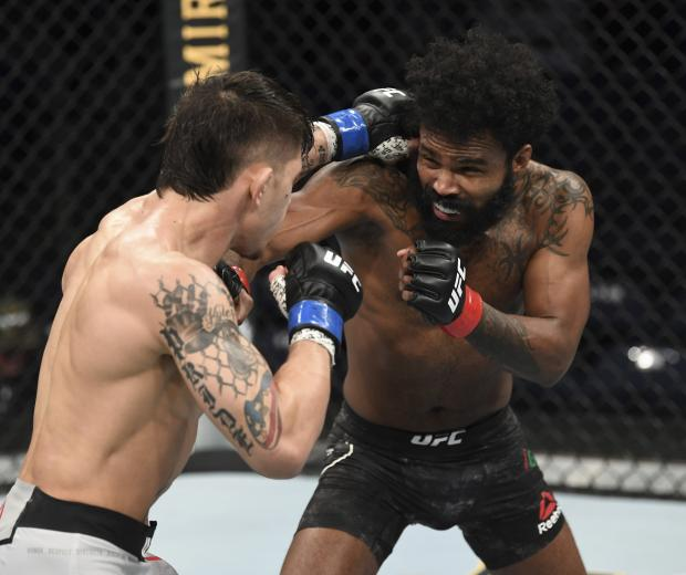 NORFOLK, VA - FEBRUARY 29: (R-L) Jordan Griffin punches TJ Brown in their featherweight bout during the UFC Fight Night event at Chartway Arena on February 29, 2020 in Norfolk, Virginia. (Photo by Josh Hedges/Zuffa LLC)