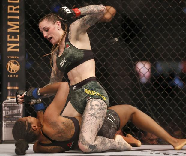 Megan Anderson of Australia punches Zarah Fairn of France in the Women's featherweight bout during UFC 243 at Marvel Stadium on October 06, 2019 in Melbourne, Australia. (Photo by Darrian Traynor/Getty Images)