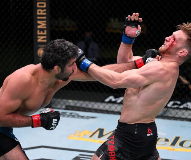 LAS VEGAS, NEVADA - AUGUST 08: (L-R) Beneil Dariush of Iran punches Scott Holtzman in their lightweight fight during the UFC Fight Night event at UFC APEX on August 08, 2020 in Las Vegas, Nevada. (Photo by Chris Unger/Zuffa LLC)