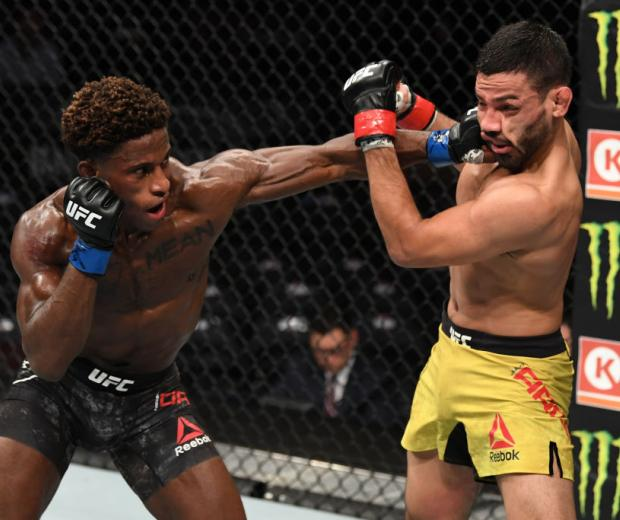 NEW YORK, NEW YORK - NOVEMBER 02: (L-R) Hakeem Dawodu of Canada punches Julio Arce in their featherweight bout during the UFC 244 event at Madison Square Garden on November 02, 2019 in New York City.