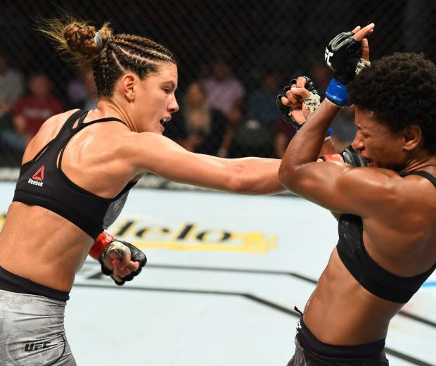 Cortney Casey punches Angela Hill in their womens strawweight fight during the UFC Fight Night event at Pinnacle Bank Arena on August 25, 2018 in Lincoln, Nebraska. (Photo by Josh Hedges/Zuffa LLC)