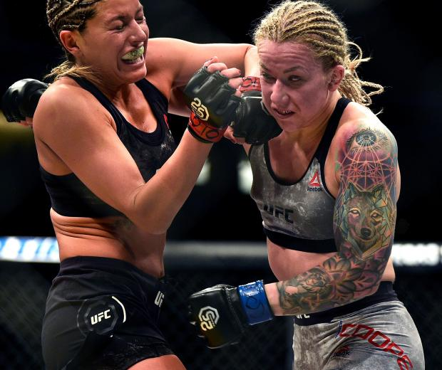 Ashley Yoder punches Amanda Cooper in their women's strawweight bout during the UFC Fight Night event inside Pepsi Center on November 10, 2018 in Denver, Colorado. (Photo by Chris Unger/Zuffa LLC)