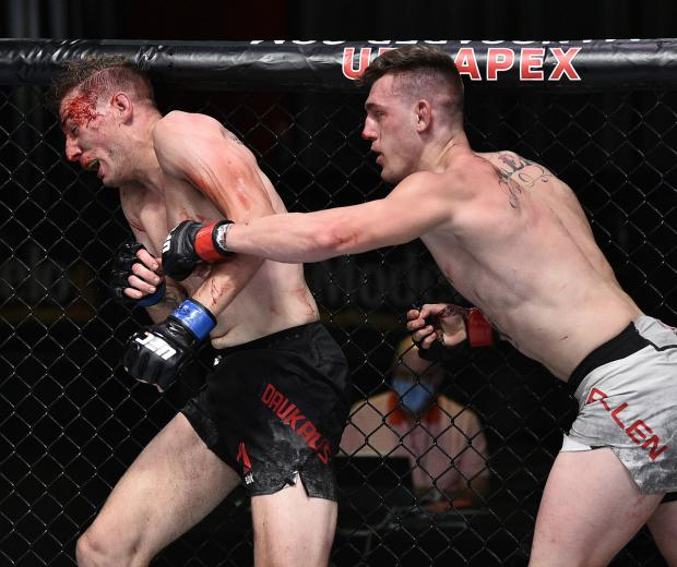 Brendan Allen punches Kyle Daukaus in their middleweight fight during the UFC Fight Night event at UFC APEX on June 27, 2020 in Las Vegas, Nevada. (Photo by Chris Unger/Zuffa LLC)
