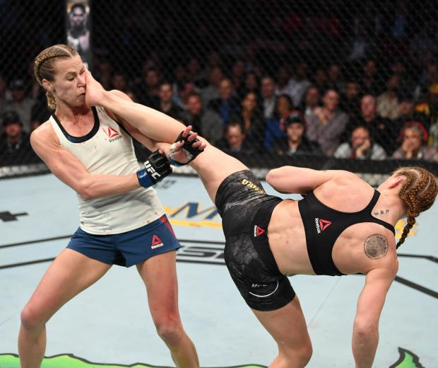 Valentina Shevchenko of Kyrgyzstan kicks Katlyn Chookagian in their women's flyweight championship bout during the UFC 247 event at Toyota Center on February 08, 2020 in Houston, Texas. (Photo by Josh Hedges/Zuffa LLC via Getty Images)