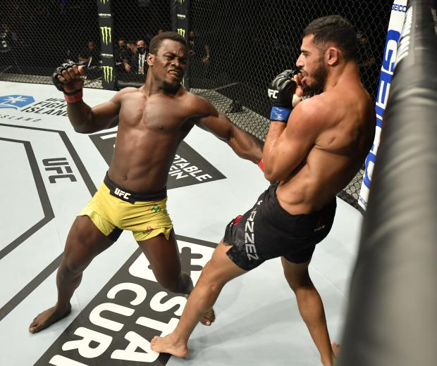 Abdul Razak Alhassan of Ghana punches Mounir Lazzez of Tunisia in their welterweight fight during the UFC Fight Night event inside Flash Forum on UFC Fight Island on July 16, 2020 in Yas Island, Abu Dhabi, United Arab Emirates. (Photo by Jeff Bottari/Zuffa LLC via Getty Images)