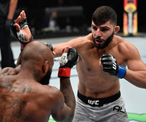 ABU DHABI, UNITED ARAB EMIRATES - JULY 19: (R-L) Amir Albazi of Iraq punches Malcolm Gordon of Canada in their bantamweight bout inside Flash Forum on UFC Fight Island on July 19, 2020 in Abu Dhabi, United Arab Emirates. (Photo by Jeff Bottari/Zuffa LLC)