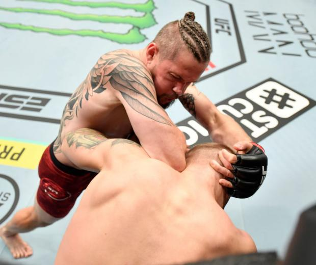 ABU DHABI, UNITED ARAB EMIRATES - JULY 26: (L-R) Nicolas Dalby of Denmark elbows Jesse Ronson of Canada in their welterweight fight during the UFC Fight Night event inside Flash Forum on UFC Fight Island on July 26, 2020 in Abu Dhabi, United Arab Emirates. (Photo by Jeff Bottari/Zuffa LLC)