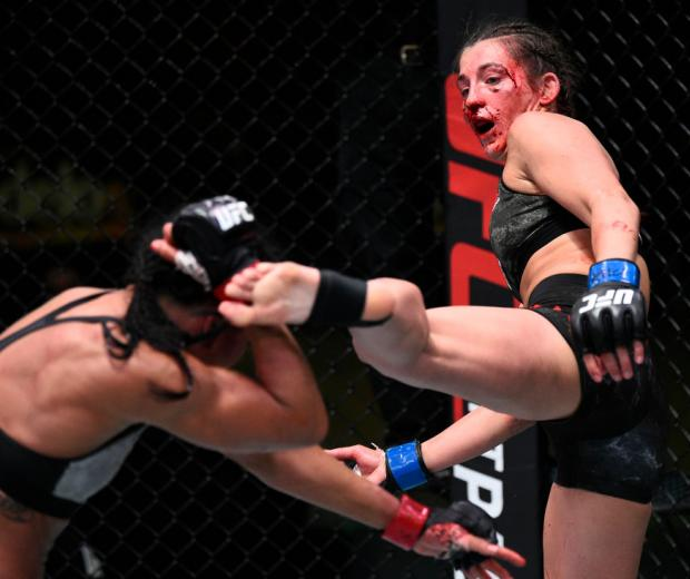 LAS VEGAS, NEVADA - SEPTEMBER 05: (R-L) Montana De La Rosa kicks Viviane Araujo of Brazil in a flyweight fight during the UFC Fight Night event at UFC APEX on September 05, 2020 in Las Vegas, Nevada. (Photo by Chris Unger/Zuffa LLC)