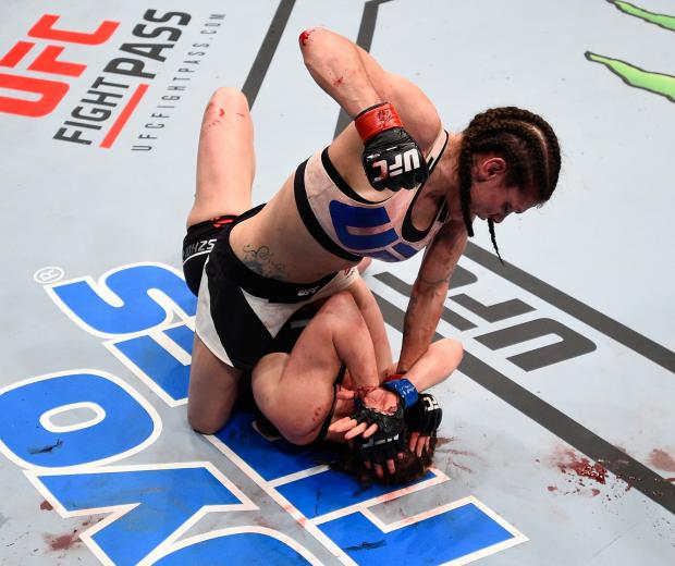 Lauren Murphy (top) punches Faszholz in their women's bantamweight bout during the UFC Fight Night event at Consol Energy Center on February 21, 2016 in Pittsburgh, Pennsylvania. (Photo by Jeff Bottari/Zuffa LLC via Getty Images)