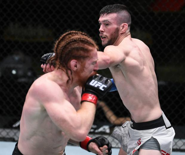In this handout image provided by the UFC, Bill Algeo (R) punches Spike Carlyle in their featherweight bout during the UFC Fight Night at UFC APEX on November 28, 2020 in Las Vegas, Nevada. (Photo by Chris Unger/Zuffa LLC)