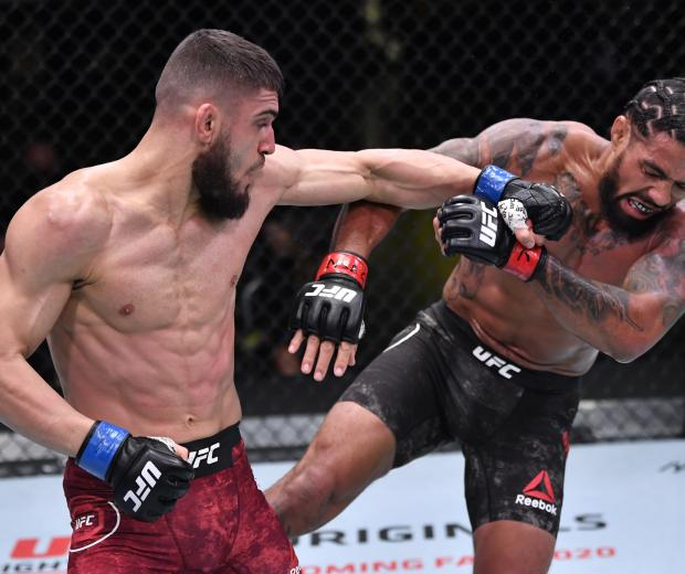 Ramiz Brahimaj punches Max Griffin in a welterweight fight during the UFC Fight Night event at UFC APEX on November 07, 2020 in Las Vegas, Nevada. (Photo by Jeff Bottari/Zuffa LLC)