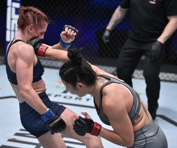 Cheyanne Buys punches Hilarie Rose in a strawweight bout during week three of Dana White's Contender Series Season 4 at UFC APEX on August 18, 2020 in Las Vegas, Nevada. (Photo by Chris Unger/DWCS LLC/Zuffa LLC)