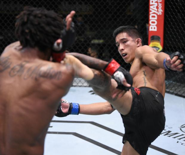 Vince Cachero kicks Jamall Emmers in their featherweight fight during the UFC Fight Night event at UFC APEX on August 01, 2020 in Las Vegas, Nevada. (Photo by Chris Unger/Zuffa LLC)