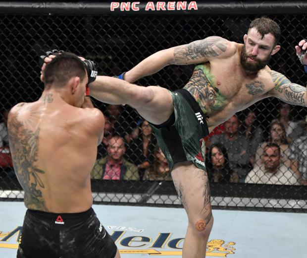Michael Chiesa kicks Rafael Dos Anjos of Brazil in their welterweight fight during the UFC Fight Night event at PNC Arena on January 25, 2020 in Raleigh, North Carolina. (Photo by Jeff Bottari/Zuffa LLC)